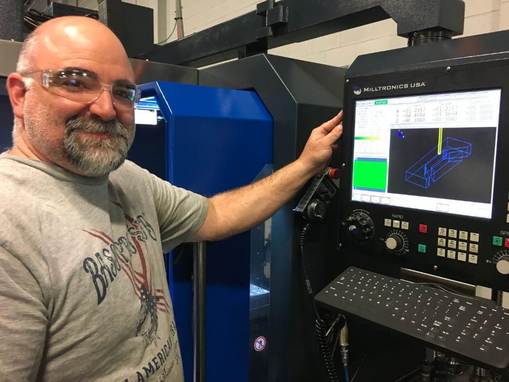 Stecker employee working at a CNC machine